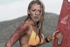 After a run-in with the shark, she ends up on a rock 200m from shore with the tide rising, losing blood from a leg wound in the movie The Shallows.