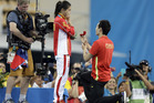 China's silver medalist He Zi, left, receivers a marriage proposal by China's diver Qin Ki, right, during the medal ceremony. Photo / AP