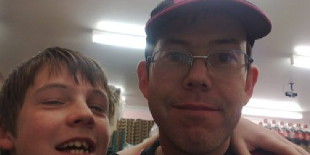 Former Eagle Boys franchisee Andrew Kynaston with his son. Photo / Supplied