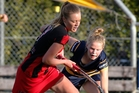 Springfield's Jess Heywood, left, and Old Girls' Sophie Morrison battle for possession during Old Girls' 3-2 win.