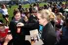 The Hits and Simply Squeezed give away probiotic juice at Havelock North Domain. Photo / Paul Taylor