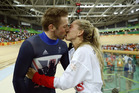 Gold medallist Laura Trott, right, kisses her fiance Jason Kenny, left, both of Britain, after he won the men's keirin cycling final . Photo / AP