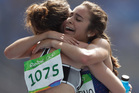 Abbey D'Agostino hugs Nikki Hamblin at the end of their 5000m heat. Photo / Getty