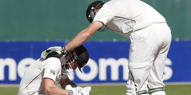Kane Williamson takes a break after being hit in the body by a Dale Steyn delivery.