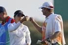 Lydia Ko greets her caddie Jason Hamilton on the 18th hole. Photo / AP