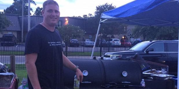 Christian Dornhorst serves barbecue to displaced flood victims. Photo / the Washington Post.