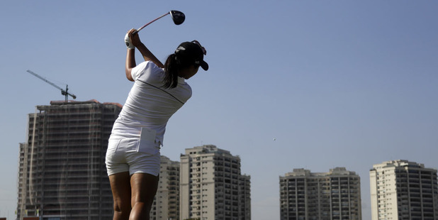 Lydia Ko tees off during a practice round ahead of the Rio Olympics golf event. Photo / AP