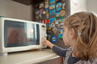Despite being a common kitchen appliance, a radiation expert advises keeping children away from microwaves. Photo / Getty