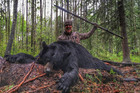 Josh Bowmar  who speared a black bear and captured the hunt in a YouTube video. Photo / Twitter, from YouTube video