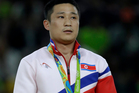 Ri Se-Gwang, from North Korea appeared to be fighting back tears after taking gold in the gymnastics vault. Photo / AP