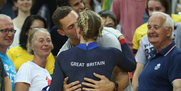 Rebecca James of Great Britain celebrates winning the silver medal with a kiss from Welsh rugby winger George North. Photo / Getty