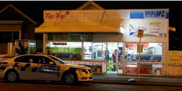 Loading A policeman talks to a St Kilda shopkeeper in Dunedin last night after an attempted robbery by a masked woman. Photo / Linda Robertson, Otago Daily Times