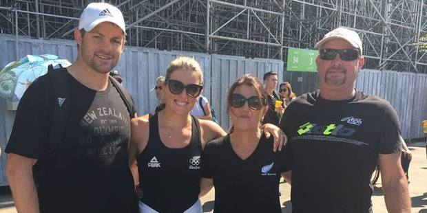 Richie McCaw with Gemma Flynn and parents after the quarter final win over Australia by the Blacksticks women's hockey team at the Rio Olympics. Photo / Richie McCaw Facebook