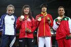 Silver medalist Mariya Stadnik of Azerbaijan, left, wasn't too impressed with her silver medal. Photo / Getty