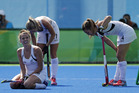 Players from New Zealand react at the end of the match after losing to Germany during a women's field hockey bronze medal match. Photo / AP