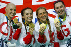 Britain's team, from left, Joanna Rowsell Shand, Elinor Barker, Laura Trott and Katie Archibald pose with their gold medals. Photo / AP