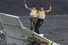 New Zealand's Peter Burling, left, and Blair Tuke celebrate after winning the 49er men gold medal. photo / AP