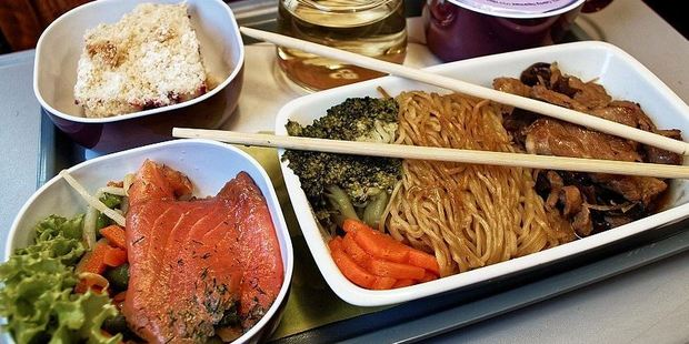 While travelling from Kunming to Bangkok on Thai Airways, Loukas enjoyed a meal featuring pork with noodles, a salmon salad and plenty of fresh vegetables. Photo: Nik Loukas / inflightfeed.com