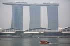 The Marina Bay Sands Integrated Resort fades away as Singapore's air is fouled by forest fires. Photo / AP