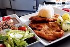 Nik Loukas flies around the world just to try airline food. For just €14, Loukas received 'the best chicken schnitzel at 35,000ft' on FlyNiki. Photo: Nik Loukas / inflightfeed.com