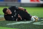 New Zealand All Blacks winger Waisake Naholo holds his hamstring after scoring against Australia. Photo / Brett Phibbs