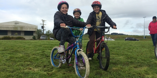Brianna Bowmar, 10, Coby Chambers, 8, and Marrac Bowmar, 8, ready to cycle onto the Onerahi/Riverside shared path which was officially opened at 10am yesterday. Photo / Mikaela Collins