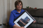 Judy Richards holds a photo of her son Rhys Middleton who was killed by a foreign driver. Photo/John Borren