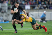 All Blacks Ben Smith beating Wallabies first five-eighths Quade Cooper. Photo / Mark Mitchell