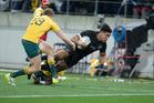 All Blacks wing Julian Savea scoring against the Wallabies. Photo / Mark Mitchell