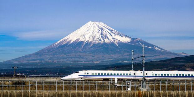 A bullet train zips past Mt Fuji. Photo / 123RF