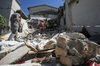 Firefighters search for survivors in the rubble in Accumoli, one of the towns hardest hit by Wednesday's earthquake. Photo / AP