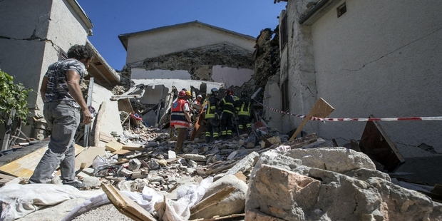 Loading Firefighters search for survivors in the rubble in Accumoli, one of the towns hardest hit by Wednesday's earthquake. Photo / AP