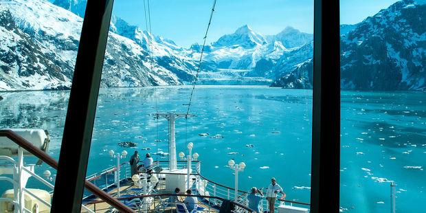 Visitors cruise through Glacier Bay. Photo / 123RF