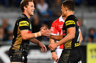 Matthew Moylan and Nathan Cleary of the Panthers celebrate keeping the Warriors in the hunt. Photo / Getty