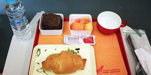 On a Delhi to Paris flight with Air India, Loukas was disappointed to find that the second meal of the journey was a meagre croissant. Photo: Nik Loukas / inflightfeed.com