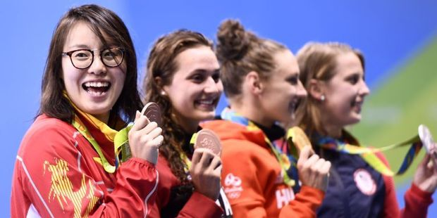 """Fu Yuanhui (L) became a social media sweetheart for claiming she had used """"primeval force"""" in a semifinal. Photo / AFP"""