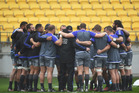 Team huddle during the New Zealand All Blacks Captain's Run at Westpac Stadium. Photo / Getty Images.