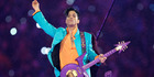 FILE - In this Feb. 4, 2007 file photo, Prince performs during the halftime show at the Super Bowl XLI football game at Dolphin Stadium in Miami. Prince's family says an official tribute concert