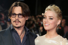 Johnny Depp and Amber Heard are scrapping again, despite settling their divorce more than a week ago. Photo/AP