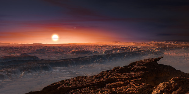 This artist rendering from the European Southern Observatory shows the surface of the planet Proxima b orbiting the red dwarf star Proxima Centauri, the closest star to the Solar System. Picture / AP
