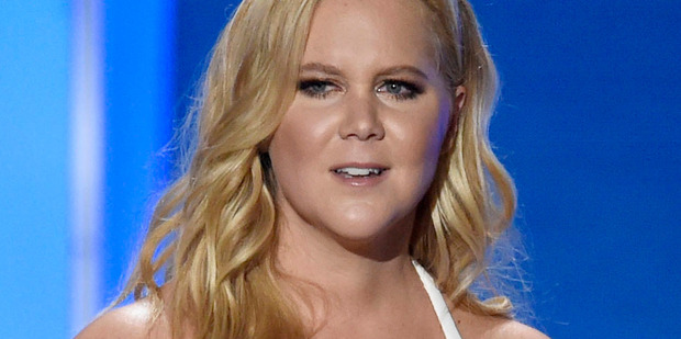 Amy Schumer says she coughed so hard she fractured her ribs during a nightmare trip to Hawaii. Photo/AP