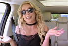 Britney Spears is caught lip syncing in a trailer for Carpool Karaoke.