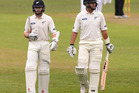 Kane Williamson and Ross Taylor of New Zealand walk off for a early lunch due to bad light during day 2. Photo / Getty Images.