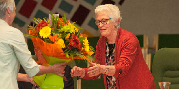 Loading Glenys Searancke receives a bouquet of flowers from council staff at her last council meeting today.  Photo/Ben Fraser