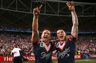 Jared Waerea-Hargreaves and Shaun Kenny-Dowall of the Roosters celebrate after winning the 2013 NRL Grand Final. Photo / Getty Images