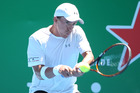Rubin Statham hits a back hand during the Heineken Open. Photo / Getty Images