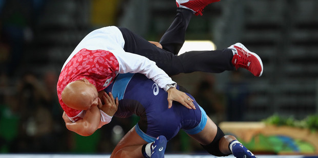 The Japanese gold medalist threw her coach to the ground before parading him around the arena on her shoulders. Photo / Getty Images