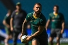 SYDNEY, AUSTRALIA - AUGUST 19: Quade Cooper looks to pass the ball during an Australian Wallabies captain's run at ANZ Stadium on August 19, 2016 in Sydney, Australia.  (Photo by Brett Hemmings/Getty Images)