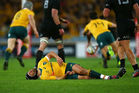 Matt Giteau of the Wallabies lies injured during the Bledisloe Cup Rugby Championship match. Photo / Getty