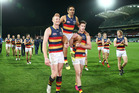 Eddie Betts of the Adelaide Crows is chaired from the field by Sam Jacobs and Josh Jenkins despite their victory being marred by an ugly fan incident. Photo / Getty Images